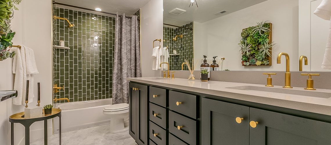 Green tile gives beauty and unique charm to this basement bathroom